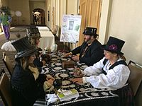 Cosplayers (left) receive steampunk tarot readings at the 2015 Salt City Steamfest