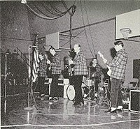 The Beach Boys, in Pendleton outfits, performing at a local high school, late 1962.