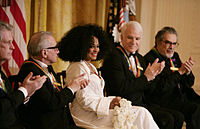 Diana Ross is applauded by her fellow Kennedy Center honorees as she is recognized for her career achievements by President George W. Bush in the East Room of the White House Sunday, December 2, 2007, during the Kennedy Center Gala Reception. From left to right: singer-songwriter Brian Wilson; filmmaker Martin Scorsese; Ross; comedian, actor and author Steve Martin, and pianist Leon Fleisher.