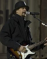 Kid Rock performs for service members during an USO tour at Al Asad Airbase's Jordan-Hare Stadium in Iraq, 2008