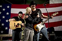Kid Rock performing for the USO with Kellie Pickler and Zac Brown in 2008