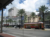 A New Orleans streetcar traveling down Canal Street