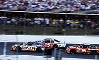 Earnhardt (far right) racing alongside Mike Skinner and Jerry Nadeau (left) at the 2000 Coca-Cola 600