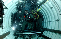 Members of SEAL Delivery Vehicle Team Two in a Dry Deck Shelter of the submerged