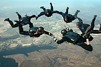 """A SEAL """"Leap Frogs"""" parachute team high above San Diego"""