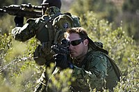 U.S. Navy SEALs conducting training with SCAR rifles.
