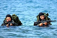 US Navy Basic Underwater Demolition-SEAL (BUD-S) students wade ashore on an Island during an exercise