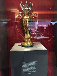 The gold Premier League trophy awarded to Arsenal for winning the 2003–04 title without defeat