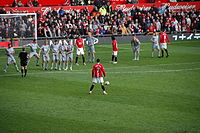 Cristiano Ronaldo preparing to take a free kick in a 2009 match between Manchester United and Liverpool.