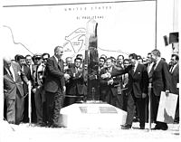 U.S. President Lyndon B. Johnson (left) and Mexican President Adolfo López Mateos (right) unveil the new boundary marker signaling the peaceful end of the Chamizal dispute