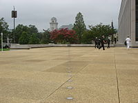 A monument at United States Naval Academy marks the path of Michelson's experiments measuring the speed of light.