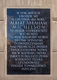 """""""Albert Abraham Michelson was born in this city on December 19, 1852. He was a professor at theUniversity of Chicago, a Nobel laureate, who, with his famous experiments on the speed of light, started a new era in the development of physics. This plaque was place to celebrate the foundation of great physics."""" A commemorative plaque in Strzelno, Poland, installed by the Polish Physical Society."""