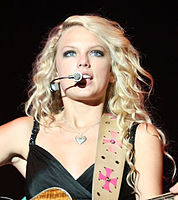 """Taylor Swift rose to fame in the late 2000s, with her unique country-pop style, spawning global hits like """"Love Story"""" and """"You Belong With Me""""."""