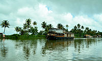 A traditional kettuvallam idling in the lake