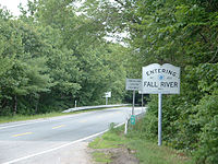 The passing of Route 177's short Fall River section into Massachusetts. Note the Westport town line sign near the center of the photo.