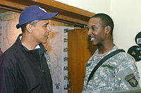 Obama speaks with a soldier stationed in Iraq, 2006.