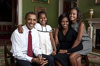 Obama poses in the Green Room of the White House with wife Michelle and daughters Sasha and Malia, 2009