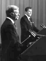 """President Jimmy Carter (left) and former Governor Ronald Reagan (right) at the presidential debate October 28, 1980. Reagan most memorably deployed the phrase """"there you go again."""""""
