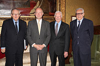 Carter (third from left) with Martti Ahtisaari, William Hague, and Lakhdar Brahimi from The Elders group in London, July 24, 2013.