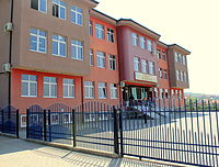 Mileniumi i Tretë school (pictured), the place where Lipa complemented her secondary studies during her stay in Kosovo.