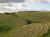 View of the ramparts of the developed hillfort of Maiden Castle, Dorset, as they look today