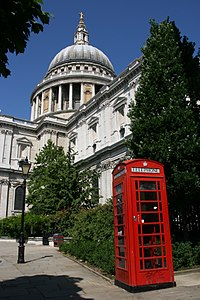 A red telephone box in front of St Paul's Cathedral, one of the most important buildings of the English Baroque period