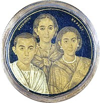 A gold glass portrait of a family from Roman Egypt. The Greek inscription on the medallion may indicate either the name of the artist or the pater familias who is absent in the portrait.