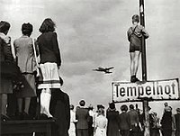 Germans watching Western supply planes at Berlin Tempelhof Airport during the Berlin Airlift