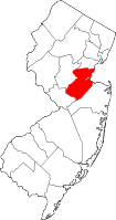 Shakur's murder trial for the Turnpike shootout took place in New Brunswick, Middlesex County, New Jersey, not far from the East Brunswick site of the gunfight.