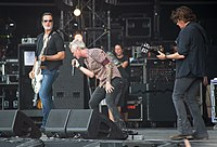 Jeff Gutt (center) with Stone Temple Pilots at Hellfest 2019.