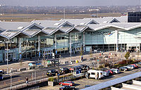 Terminal 2 at Birmingham International Airport, England. The row of concrete security barriers makes close approach by vehicles difficult.