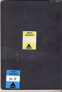 Delta Security stickers on the back of a passport