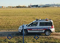Airport security car patrolling perimeters of the restricted area