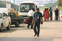 An Aetos auxiliary police officer outside the Departure Hall of Terminal 2, Singapore Changi Airport