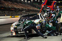 Dale Earnhardt Jr. on pit road, as his team completes a pit stop during the 2008 Dodge Challenger 500