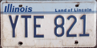 Illinois license plate design used throughout the 1980s and 1990s, displaying the Land of Lincoln slogan that has been featured on the state's plates since 1954