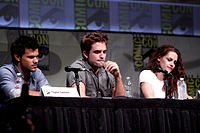 Taylor Lautner, Robert Pattinson and Stewart at a media appearance