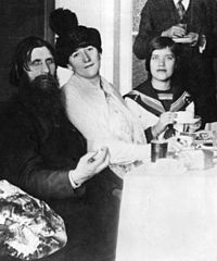 Rasputin with his wife and daughter Matryona (Maria) in his St. Petersburg apartment in 1911