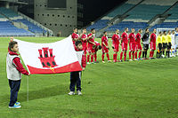 The Gibraltar national football team lining up in their first official match, against Slovakia, in 2013