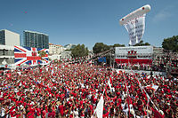 Thousands of Gibraltarians dress in their national colours of red and white during the 2013 Gibraltar National Day celebrations
