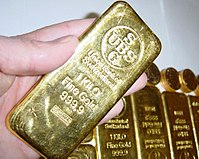 """UBS held large amounts of stolen gold in their bank vaults during World War II. Pictured: A UBS-issued gold bar, melted down from """"unclaimed assets"""" deposited in the bank."""