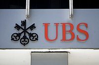 """After the two banks merged, they became known solely as """"UBS"""" while retaining the Swiss Bank Corporation's """"three keys"""" icon."""