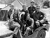 Publicity photo of the cast of M*A*S*H shot just prior to the production of Season 2, 1974 (clockwise from left): Loretta Swit, Larry Linville, Wayne Rogers, Gary Burghoff, McLean Stevenson, and Alan Alda