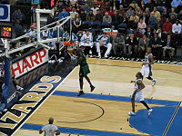 Garnett dunking a ball in a game against the Washington Wizards.