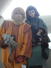 Fans in costume as Dr. Zaius and Dr. Zira at a science fiction convention