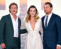 Robbie with her Once Upon a Time in Hollywood co-stars Brad Pitt (left) and Leonardo DiCaprio in 2019