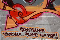 """A graffiti artist uses his artwork to make a satirical social statement on censorship: """"Don't blame yourself ... blame hip hop!"""""""
