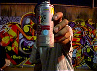 An aerosol paint can, a common tool used in modern graffiti