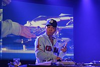 DJ Q-bert manipulating a record turntable at a turntablism competition in France in 2006.