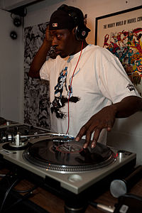 DJ Pete Rock mixing with two turntables.